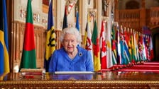 Britain's Queen urges unity in TV message hours before Harry and Meghan interview