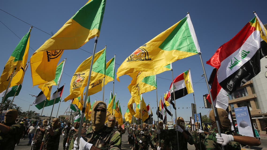 Iraqi Shiite fighters from the Iran-backed armed group, Hezbollah brigades, march during a military parade marking Al-Quds (Jerusalem) International Day in Baghdad, on May 31, 2019. An initiative started by the late Iranian revolutionary leader Ayatollah Ruhollah Khomeini, Quds Day is held annually on the last Friday of the Muslim fasting month of Ramadan and calls for Jerusalem to be returned to the Palestinians .