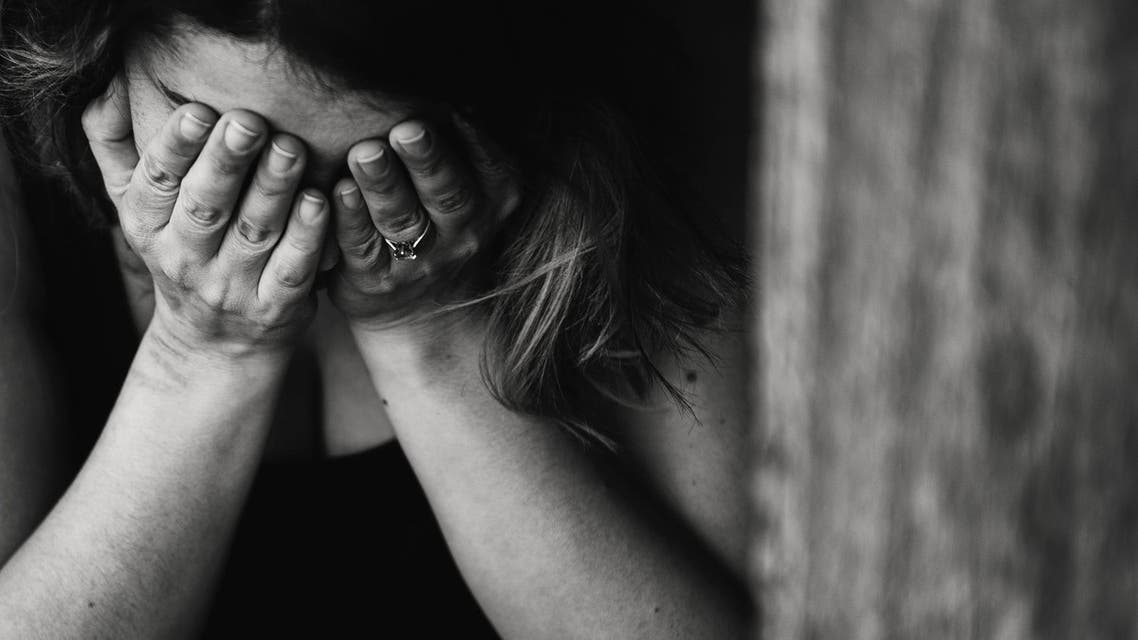 Stock image depicting a crying woman. (Pexels)