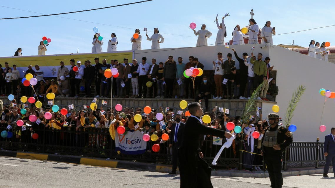 People wait for the arrival of Pope Francis near the Grand Immaculate Church, in the town of Qaraqosh, Iraq. (Reuters)