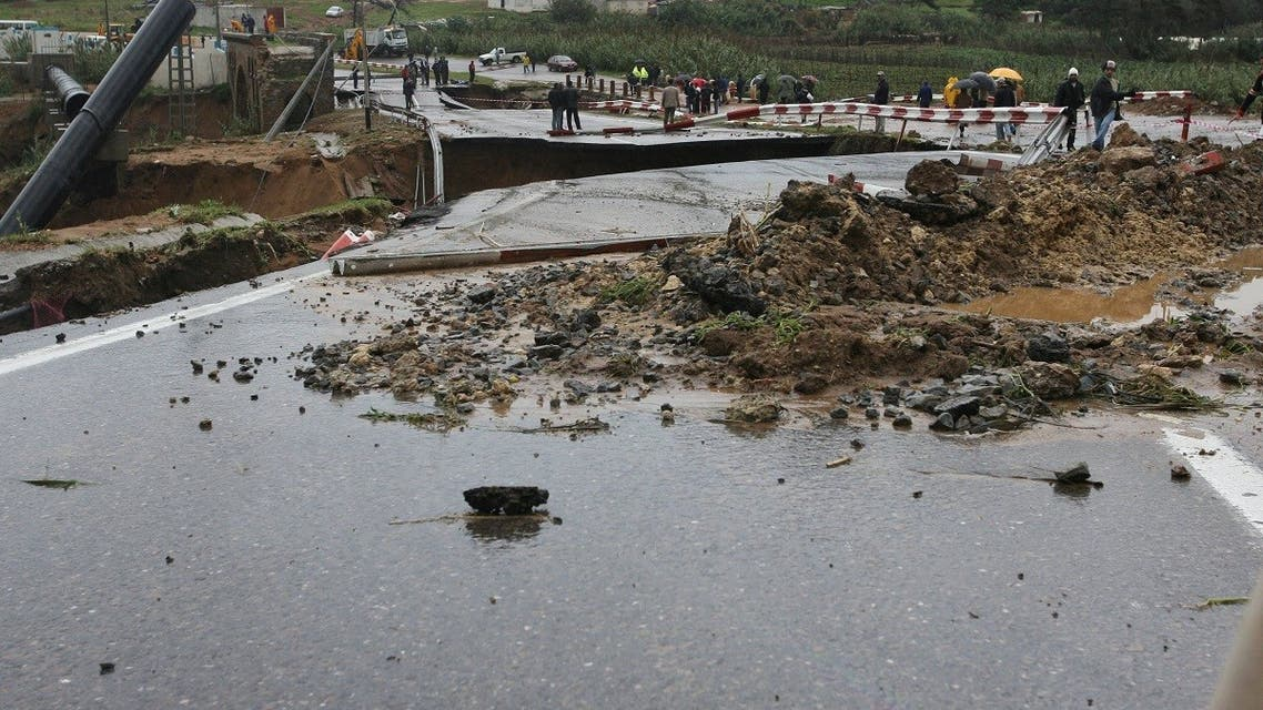 A file photo shows a collapsed bridge due to heavy rains and floods in Algiers capital, 27 November 2007. (AFP)
