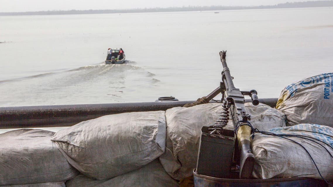 A machine gun is seen on a sandbag on a boat off the Atlantic coast in Nigeria's Bayelsa state December 19, 2013. (Reuters)