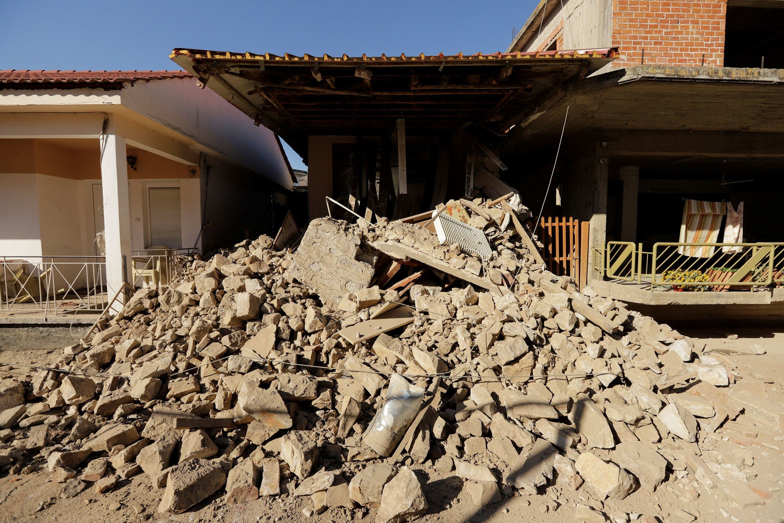 A view of a damaged house following an earthquake in the village of Damasi, in central Greece, March 3, 2021. (Reuters)