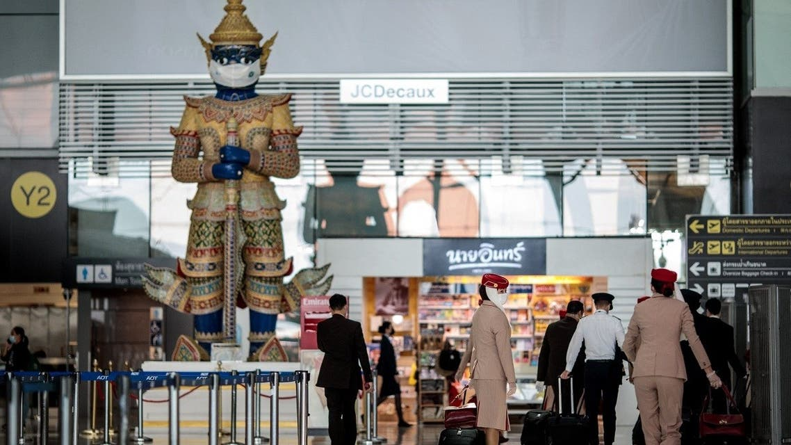 A traditional Thai statue wears a face mask as a campaign for travelers to prevent the spread of COVID-19 at the departure terminal of Suvarnabhumi International Airport in Bangkok on December 18, 2020. (Jack Taylor/AFP)