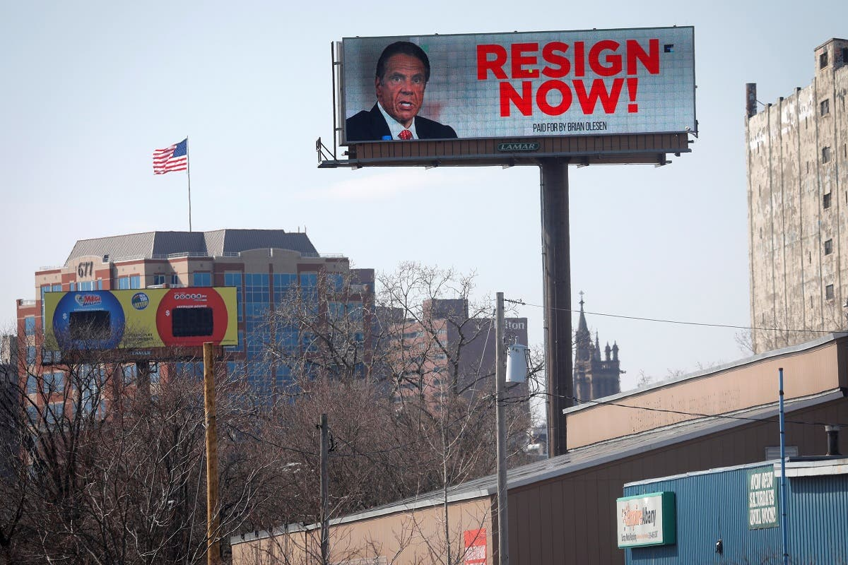 Electronic billboard displays message for New York Governor Andrew Cuomo to Resign Now in Albany. (Reuters)