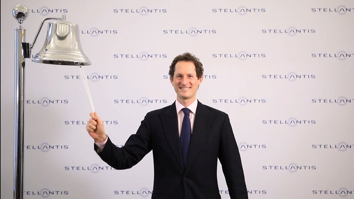 Stellantis Chairman John Elkann symbolically rings a bell as shares in the merger between Fiat Chrysler and Peugeot maker PSA began being traded at the Italian stock exchange, in Milan, Italy, on January 18, 2021. (Reuters)