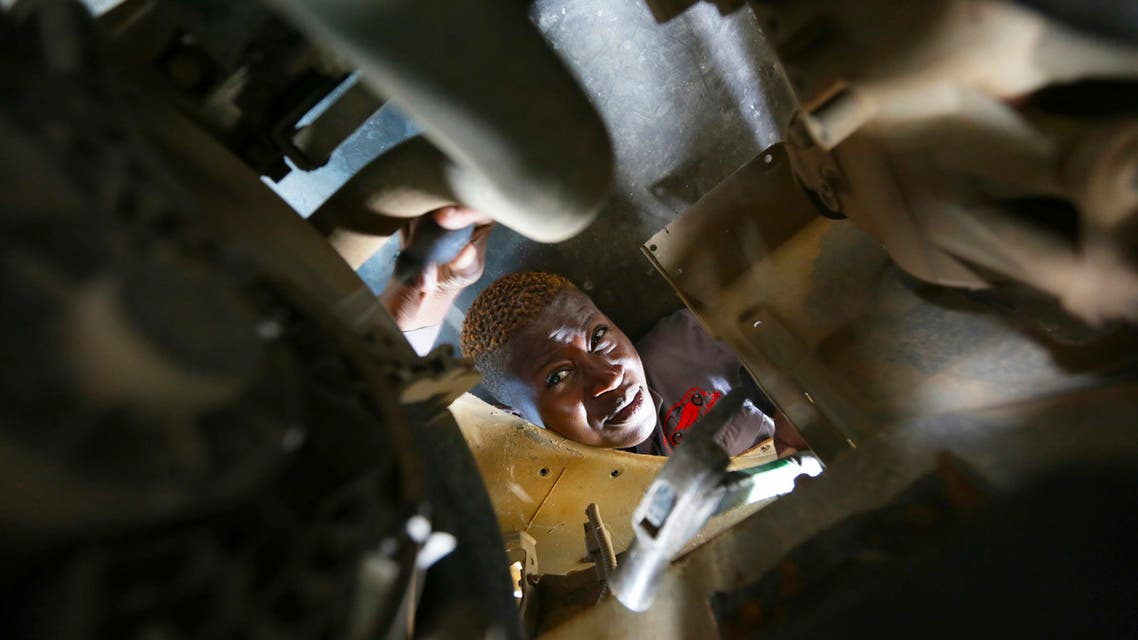 Memory Mukabeta repairs a car at her workshop in Harare, in this Friday, March,5, 2021 photo. (AP)