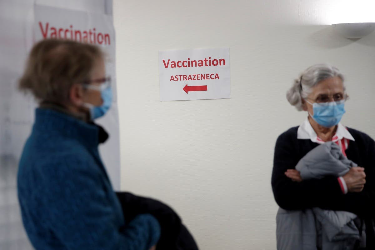 People wait to receive the AstraZeneca COVID-19 vaccine at the Clinique de l'Estree - ELSAN private hospital in Stains as part of the coronavirus vaccination campaign in France, March 5, 2021. (Reuters/Benoit Tessier)