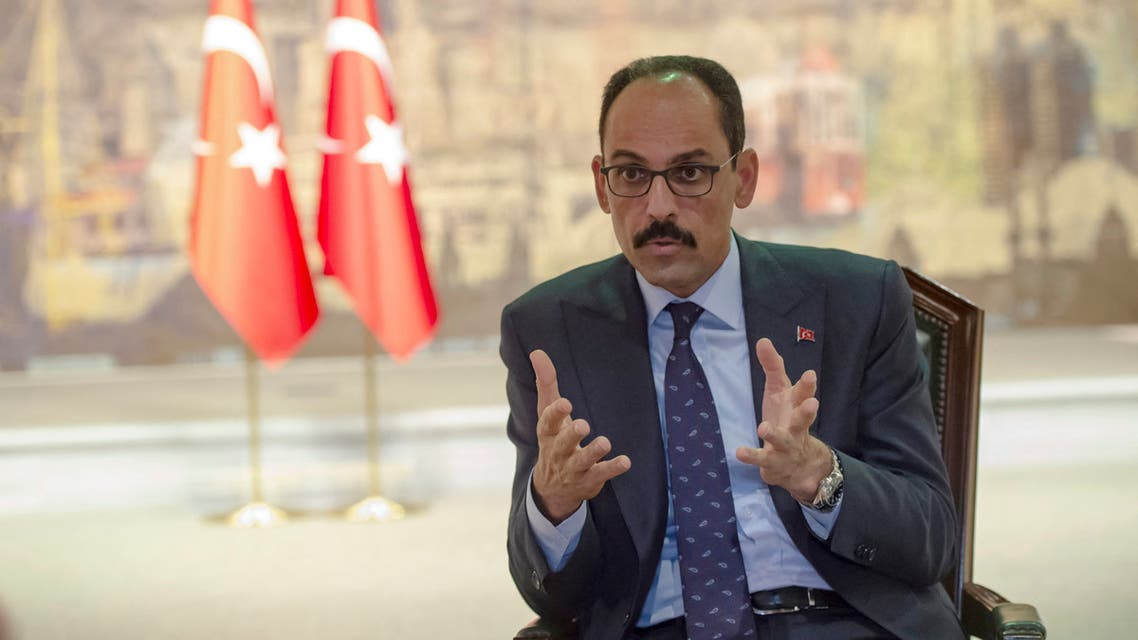 Turkey's Presidential Spokesperson İbrahim Kalın gestures as he speaks during an interview with AFP on October 19, 2019 in Istanbul. Turkey on Saturday urged the United States to use its leverage over Syrian Kurdish forces to ensure an orderly pullout under an agreement reached with Washington, the presidency spokesman said.