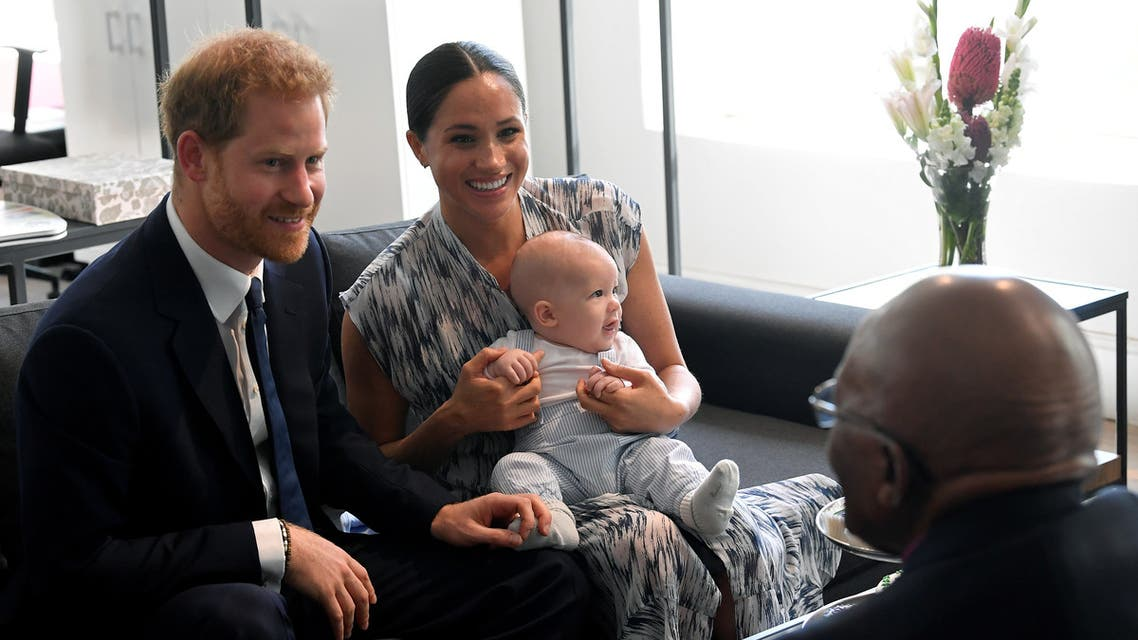 FILE PHOTO: Britain's Prince Harry and his wife Meghan, Duchess of Sussex, holding their son Archie, meet Archbishop Desmond Tutu at the Desmond & Leah Tutu Legacy Foundation in Cape Town, South Africa, September 25, 2019. REUTERS/Toby Melville/Pool/File Photo