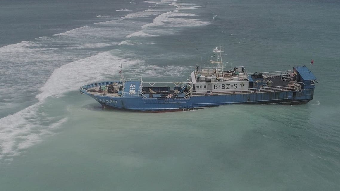 An aerial view taken on March 8, 2021, shows Chinese fishing vessel Lurong Yuan Yu that ran aground on reefs of Pointe-aux-Sables in Port Louis, Mauritius, on March 7, 2021. (L'Express Maurice/AFP)