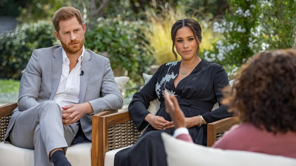 This undated image released March 7, 2021 courtesy of Harpo Productions shows Britain's Prince Harry (L) and his wife Meghan (C), Duchess of Sussex, in a conversation with US television host Oprah Winfrey. (Harpo Productions via AFP)