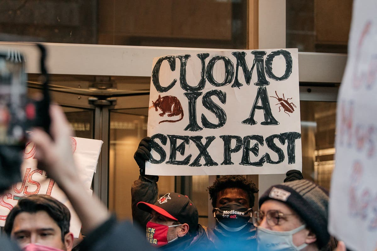 Demonstrators call on New York Gov. Andrew Cuomo to resign at a rally on March 2, 2021 in New York City. (AFP)