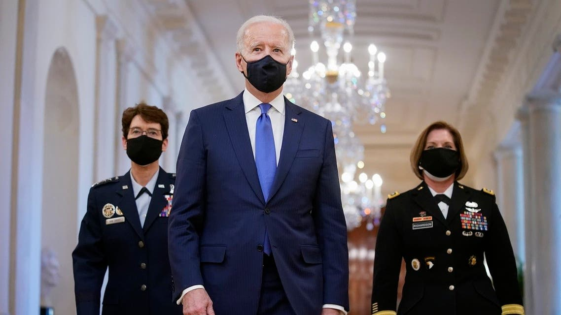 President Joe Biden walks with Air Force Gen. Jacqueline Van Ovost, left, and Army Lt. Gen. Laura Richardson before speaking at an event to mark International Women's Day, Monday, March 8, 2021, in the East Room of the White House in Washington. (AP)