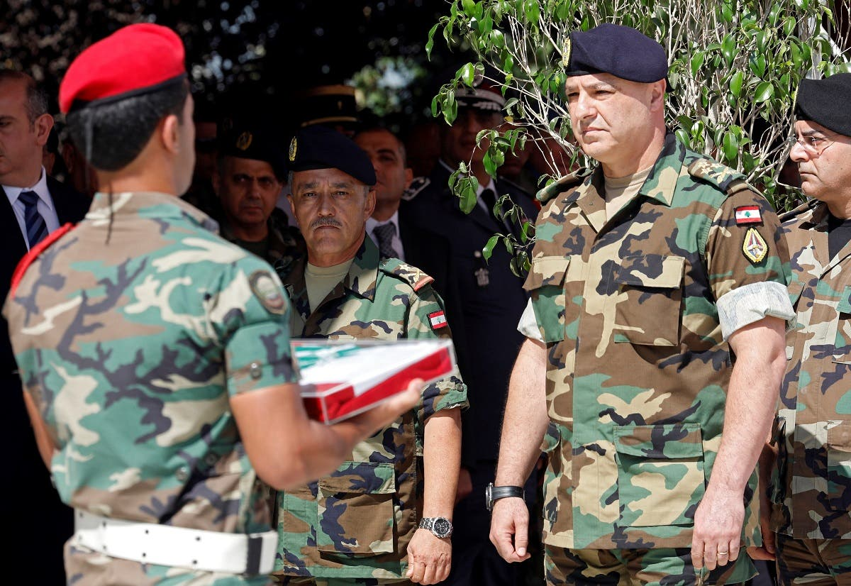 Army Commander General Joseph Aoun attends the official funeral ceremony for the Lebanese soldiers who were killed in ISIS captivity. (File Photo: Reuters)