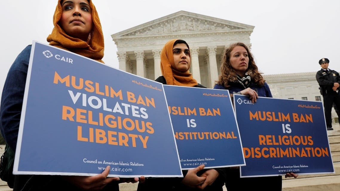 Protesters gather outside the U.S. Supreme Court, while the court justices consider case regarding presidential powers as it weighs the legality of President Donald Trump's latest travel ban targeting people from Muslim-majority countries, in Washington, DC, U.S., April 25, 2018.  (Reuters)