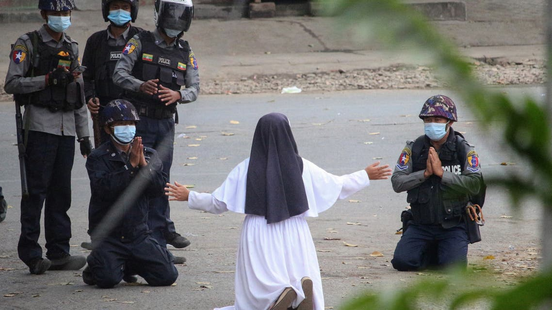 March 9 by the Myitkyina News Journal shows a nun pleading with police not to harm protesters in Myitkyina in Myanmar's Kachin state, amid a crackdown on demonstrations against the military coup. (File photo: AFP)