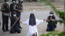 Nun kneels in front of police to stop Myanmar violence