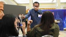 Thai PM sprays reporters with sanitizer