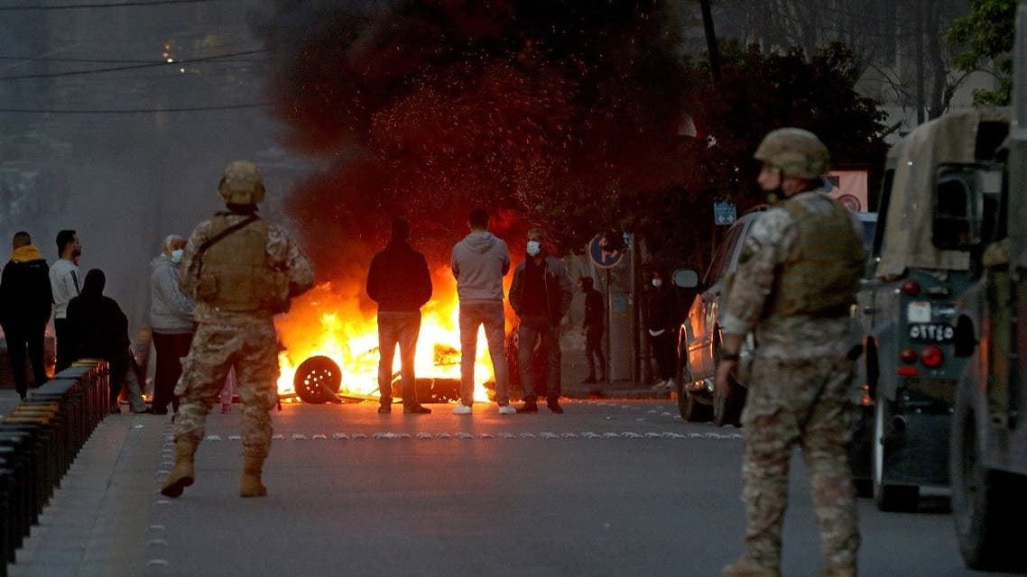 Lebanese protesters burn tires in the southern Lebanese city of Sidon on March 8, 2021. (AFP)