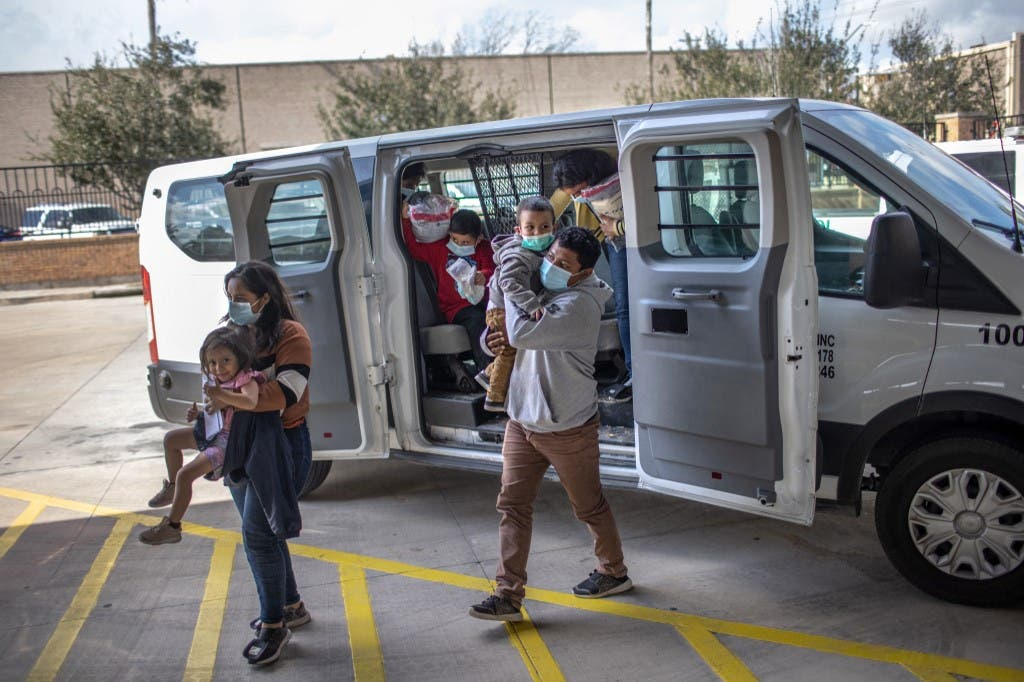 Asylum seekers are released by the US Border Patrol at a bus station on February 26, 2021 in Brownsville, Texas. (AFP)