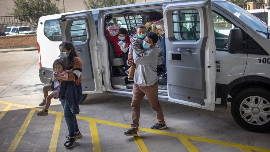 Asylum seekers are released by the U.S. Border Patrol at a bus station on February 26, 2021 in Brownsville, Texas. (AFP)