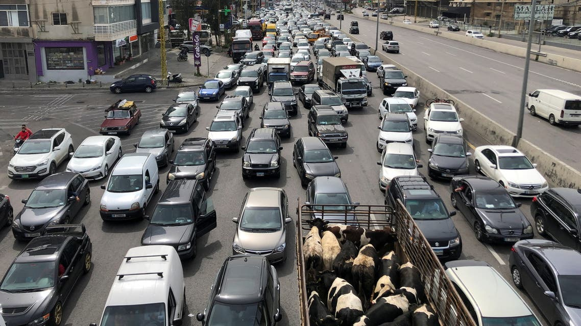 Vehicles are stuck in a traffic jam caused by demonstrators blocking a highway during a protest against the fall in Lebanese pound currency and mounting economic hardships, in Jal el-Dib, Lebanon March 9, 2021. (Reuters)