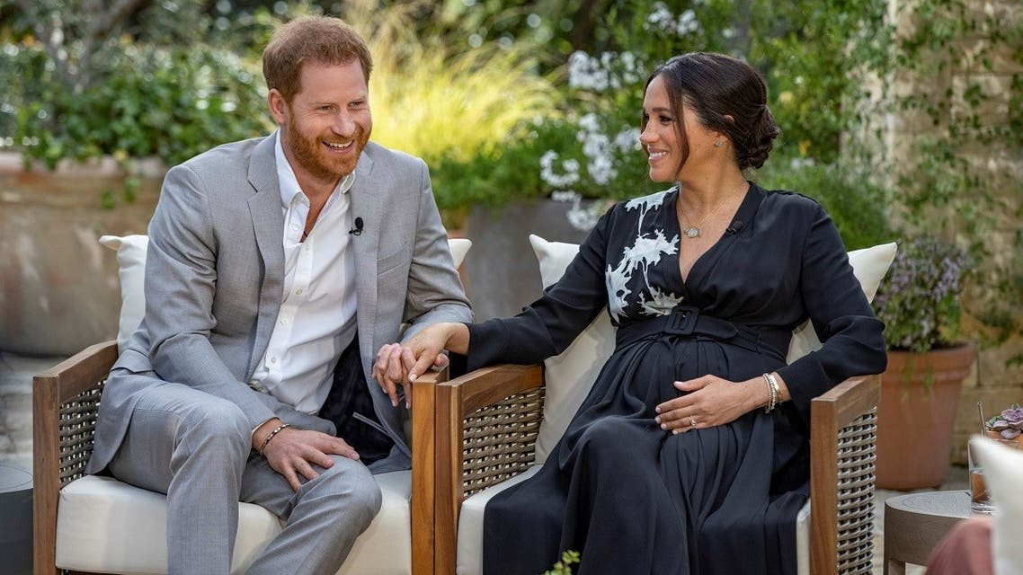 Prince Harry and Meghan give an interview to Oprah Winfrey in this undated handout photo. (Harpo Productions/Joe Pugliese/Handout via Reuters)