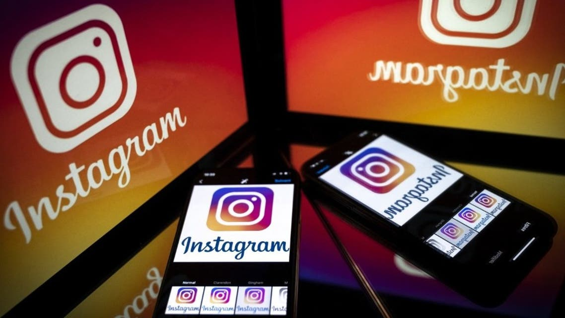 In this file photo taken on September 28, 2020 shows the logo of the social network Instagram on a smartphone and a tablet screen in Toulouse, southwestern France. (AFP)