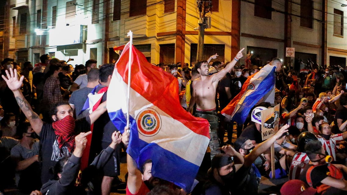 Paraguayans take part in a protest against President Mario Abdo Benitez's health policies and the lack of coronavirus disease (COVID-19) vaccines in front of the National Congress in Asuncion, Paraguay March 8, 2021. (Reuters)
