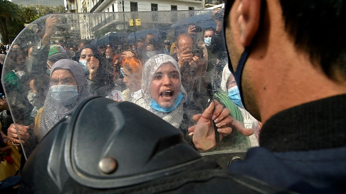 Algerian women chant slogans during an anti-government protest in the capital Algiers on March 8, 2021. (Ryad Kramdi/AFP)
