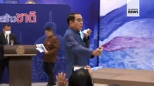 Thai Prime Minister sprays alcohol on reporters to escape questions