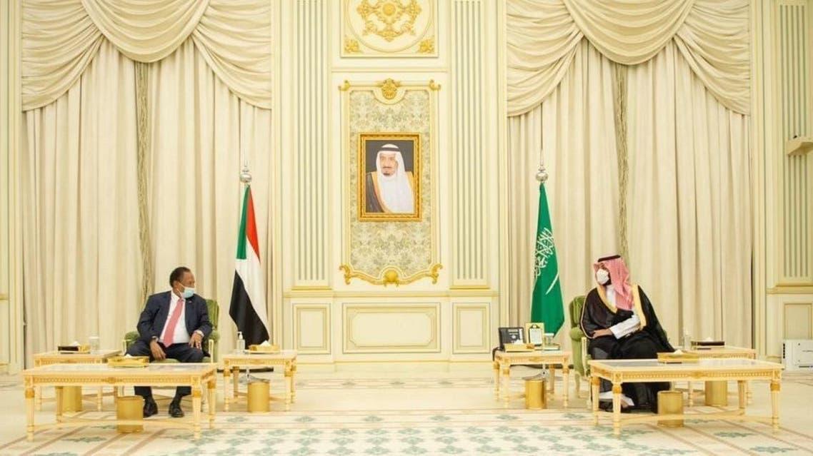 Saudi Arabia's Crown Prince Mohammed bin Salman (R) and Sudan's Prime Minister Abdalla Hamdok (L). (SPA)