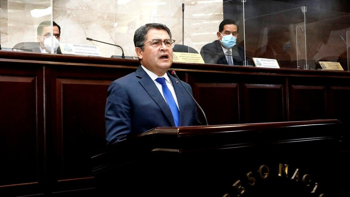 Honduras' President Juan Orlando Hernandez addresses the Congress to inform about security and organized crime, in Tegucigalpa, Honduras February 24, 2021. (Honduras' Presidency/Handout via Reuters)