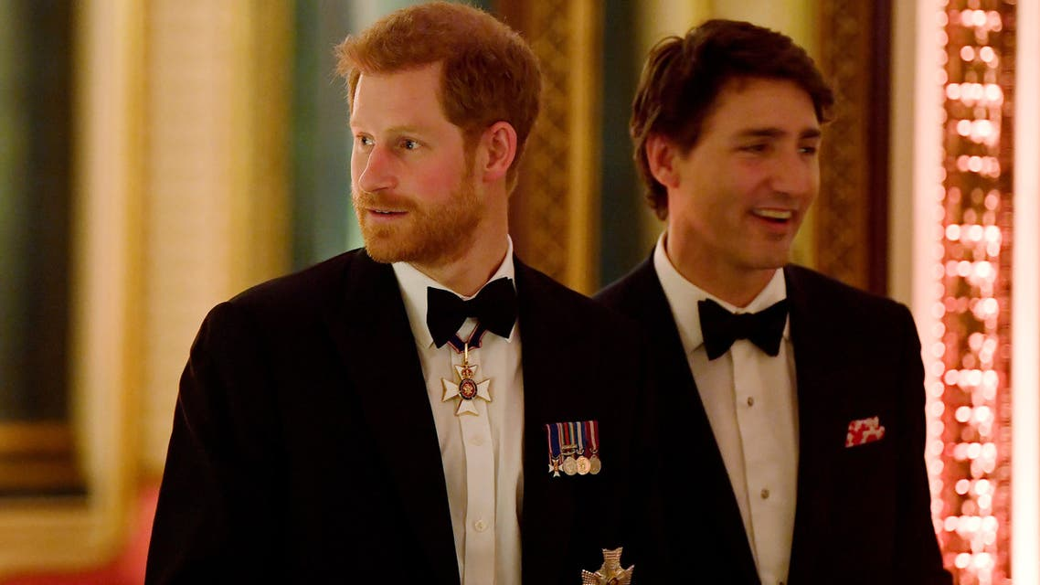 Britain's Prince Harry (L) and Canada's Prime Minister Justin Trudeau arrive to The Queen's Dinner during the Commonwealth Heads of Government Meeting at Buckingham Palace in London, Britain, April 19, 2018. (Reuters)