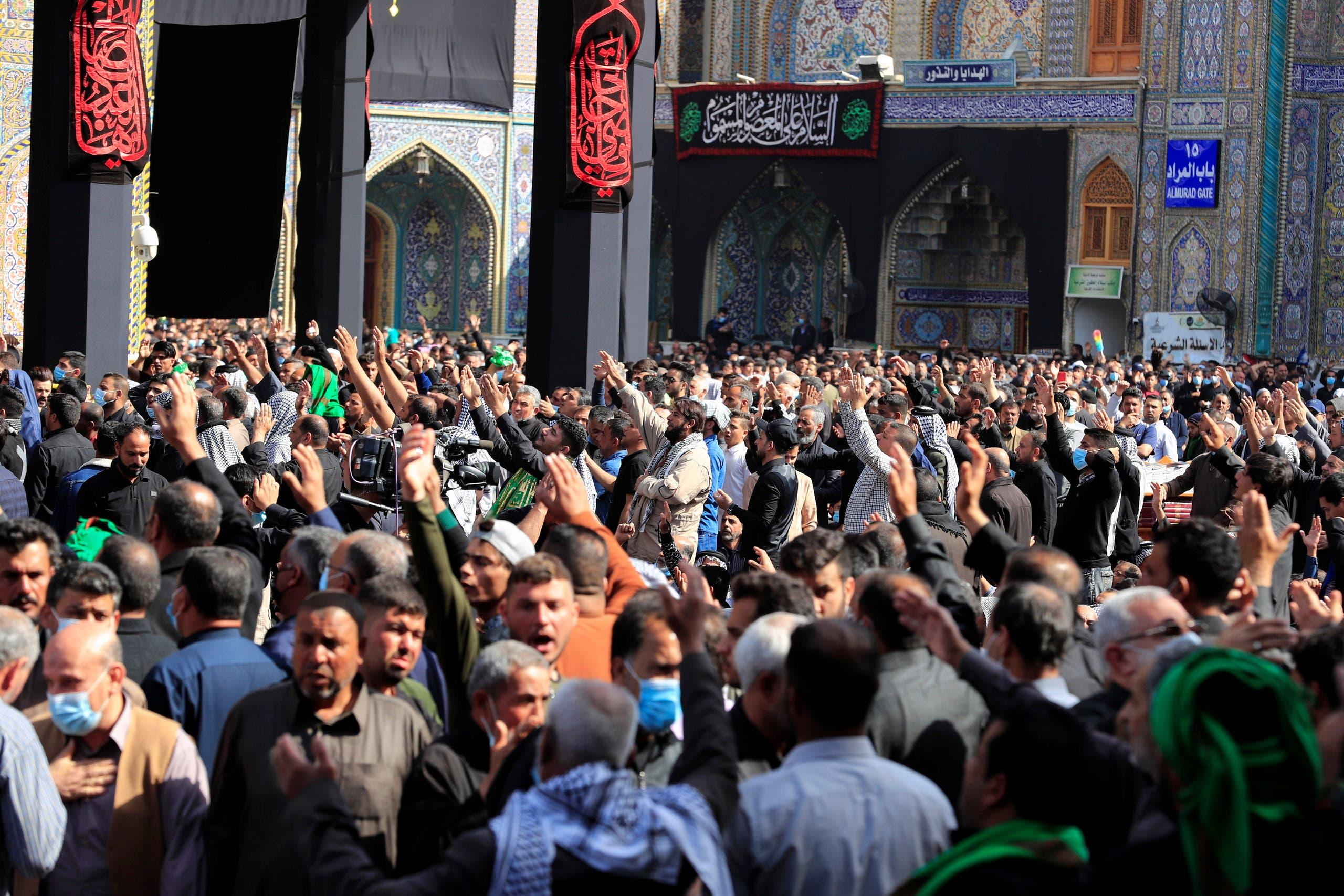 Shi'ite pilgrims gather at Imam Moussa al-Kadhim shrine to mark his death anniversary, amid the outbreak of the coronavirus disease (COVID-19), in Baghdad's Kadhimiya district, Iraq March 10, 2021. (Reuters)