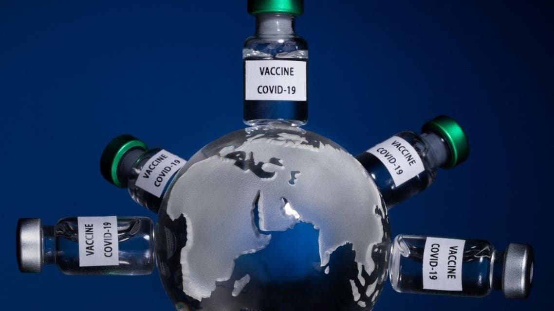 This picture taken on January 11, 2021 shows the globe with vaccine vials reading Covid-19 vaccine in Paris. (AFP)