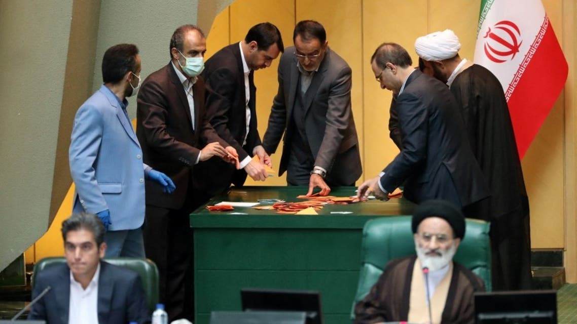 Iranian lawmakers count ballots after a vote for the new parliament speaker at the Iranian parliament in Tehran on May 28, 2020. (AFP)