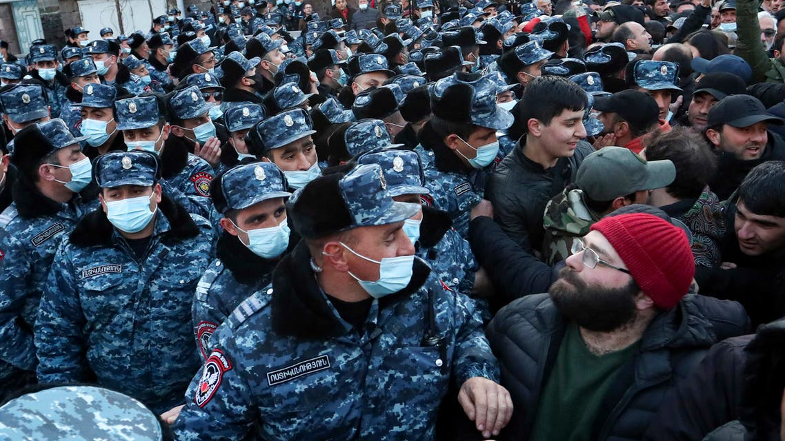 Police wearing face masks to protect against coronavirus, block opposition demonstrators during a rally to pressure Armenian Prime Minister Nikol Pashinyan to resign in Yerevan, Armenia, Tuesday, March 9, 2021. (AP)