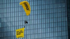 Greenpeace activist paragliders land on ECB building in climate protest