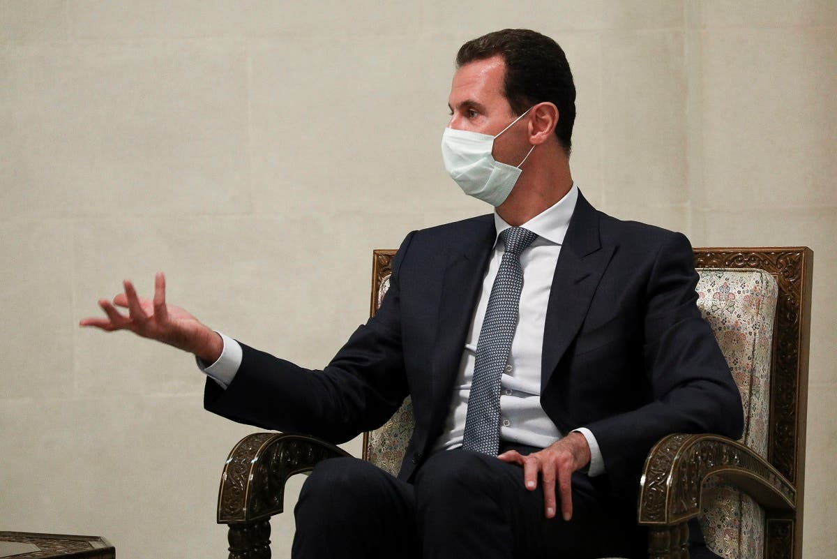 Syrian President Bashar al-Assad speaks to Russian Foreign Minister Sergey Lavrov in Damascus, Syria, Sept. 7, 2020. (AP)