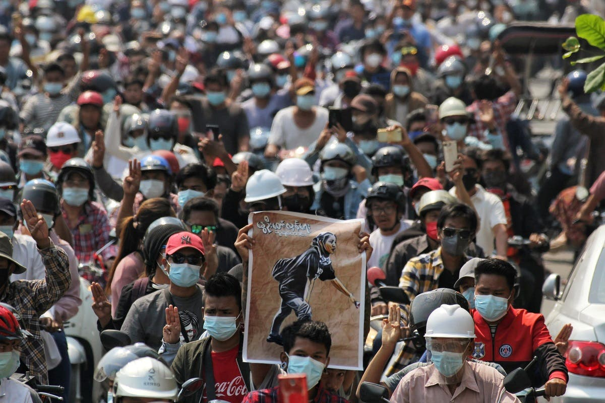 People attend the funeral of Angel a 19-year-old protester also known as Kyal Sin who was shot in the head as Myanmar forces opened fire to disperse an anti-coup demonstration in Mandalay, Myanmar, March 4, 2021. (Reuters/Stringer)