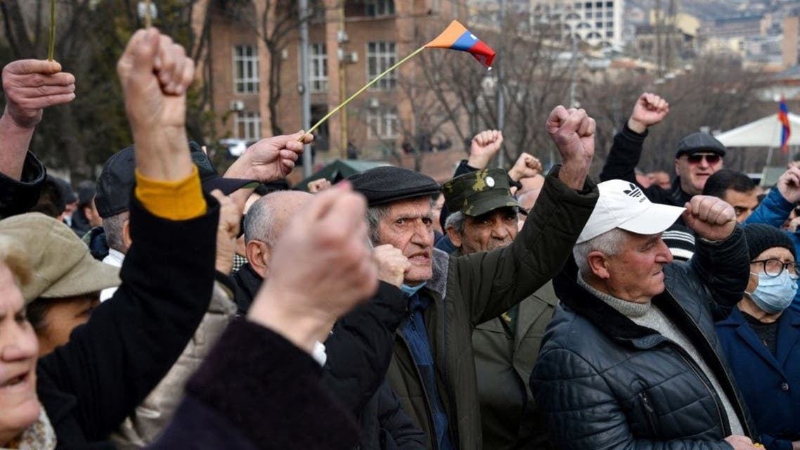 Armenian opposition supporters rally to demand the resignation of the prime minister over his handling of last year's war with Azerbaijan, in Yerevan on March 10, 2021. (AFP)