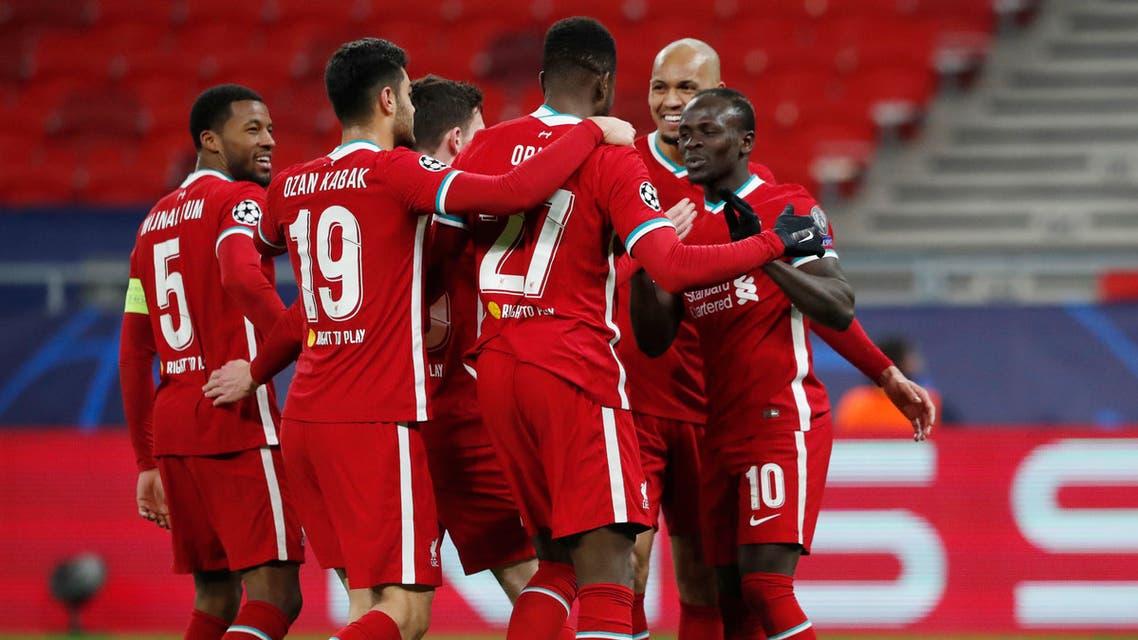 Liverpool's Sadio Mane celebrates scoring their second goal with teammates. (Reuters)