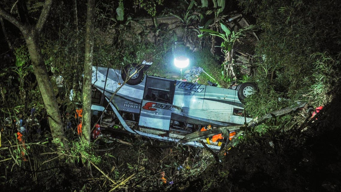 Rescuers evacuating victims of a bus accident that plunged into a ravine in Wado subdistrict, in Sumedang, West Java. (AFP)