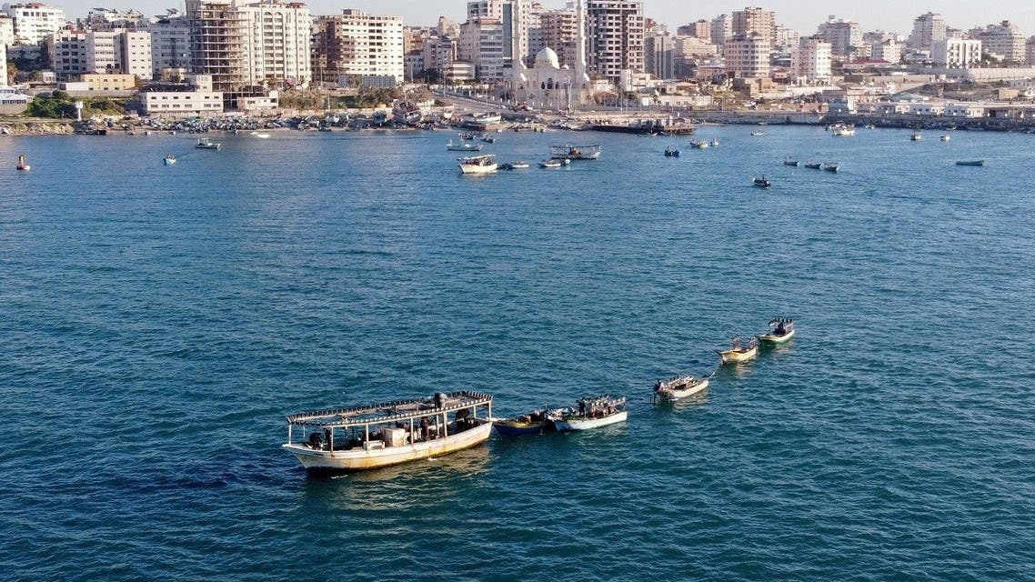 A picture taken with a drone shows Palestinian fishing boats near Gaza's seaport in Gaza City on February 1, 2021. (Reuters)