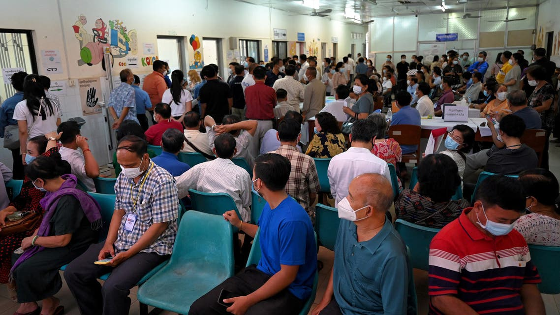 People gather as they wait to receive the Sinopharm and AstraZeneca vaccines against the Covid-19 coronavirus at a hospital in Phnom Penh on March 10, 2021. (AFP)