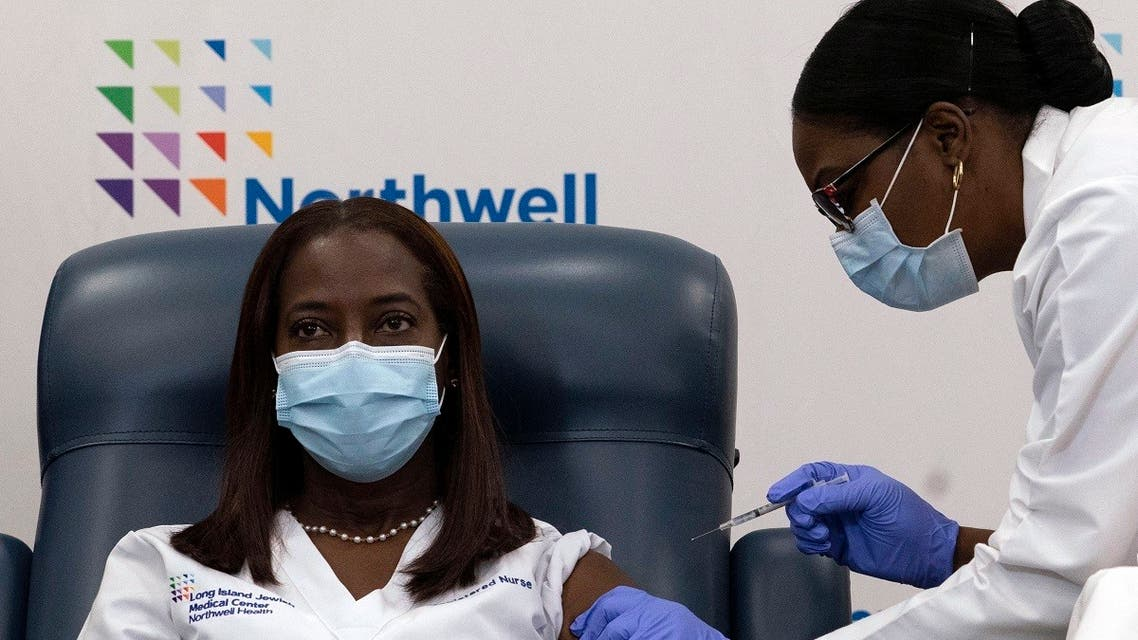 In this file photo taken on December 14, 2020, Sandra Lindsay (L), a nurse at Long Island Jewish Medical Center, is inoculated with the COVID-19 vaccine by Dr. Michelle Chester, at Long Island Jewish Medical Center, in the Queens borough of New York. (Mark Lennihan/Pool/AFP)