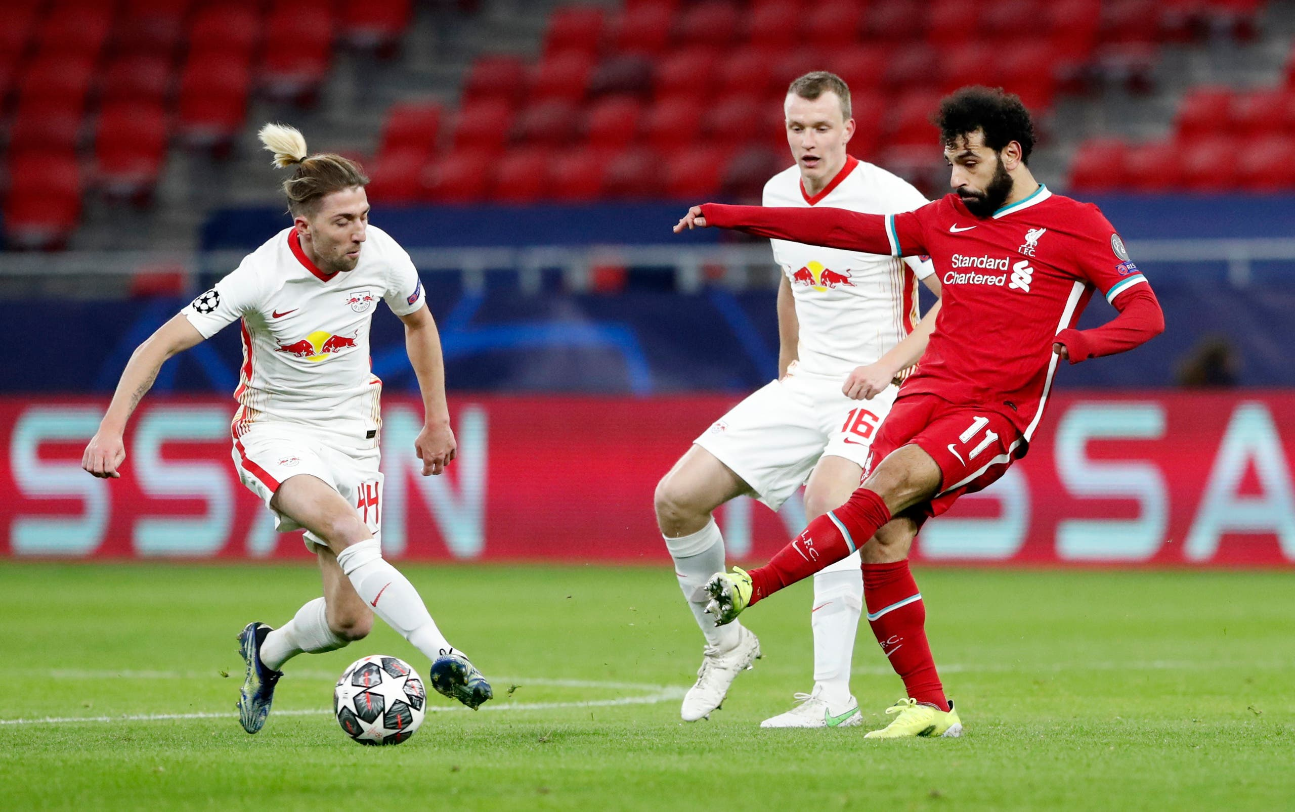 Liverpool's Mohamed Salah in action with RB Leipzig's Kevin Kampl. (Reuters)