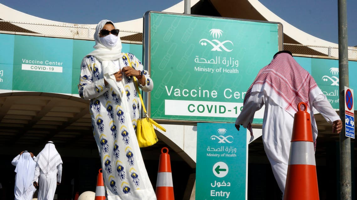 People take advantage of a new coronavirus vaccination center at the old Jeddah airport, Saudi Arabia. (AP)